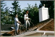 "This is during the application of ""Cedarguard"" to this roof, along with one safetyman and the other actually applying the treatment."