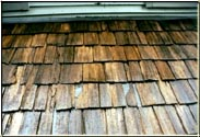 "This ""After"" example demonstrates why you should hire a company that knows how to do the repairs properly.  The previous Roof Cleaner had the opportunity to fix the problem and opted to add to the dilemma by just sliding ""Metal Shims"" under the existing cedar shakes and not replacing those shakes correctly. Costing the homeowner plenty of money."